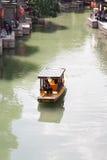 在近的老中国村庄附近的小船 免版税库存图片