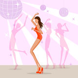 在迪斯科俱乐部的美好的妇女跳舞 免版税库存照片