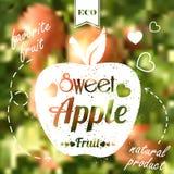 在迷离背景的甜苹果 免版税库存图片