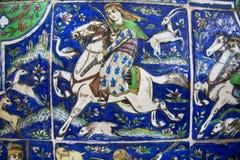 在追逐期间的猎人在葡萄酒陶瓷砖,被保存从19世纪 库存照片