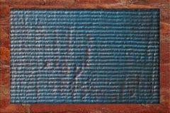 在退色的蓝色和红色的织地不很细框架 免版税图库摄影