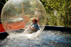 在透明球形里面的男孩 免版税库存照片