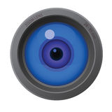 在透镜里面的照相机眼睛 免版税图库摄影