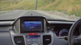 在那里模块挡风玻璃里面的汽车gps GPS模块打开 图库摄影