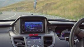 在那里模块挡风玻璃里面的汽车gps GPS模块打开 库存照片