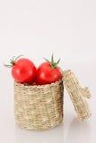 在邪恶的箱子的西红柿 库存照片