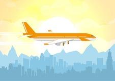 在都市城市的平面飞行 免版税库存照片