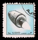 在酋长管辖区阿吉曼展示太空飞船打印的邮票 免版税库存照片