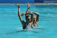 在里约时任意合作行动的希腊2016年奥运会的花样游泳二重奏惯例初步竞争 免版税库存图片