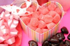 在重点形状配件箱的糖果和巧克力 库存照片