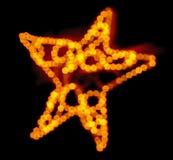 在重点彩色小灯圣诞节星形外面 库存图片
