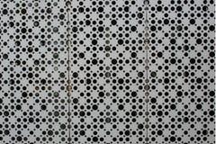 在金属板料的很大数量的孔  免版税库存照片
