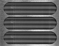 在金属片网格背景的三个漏洞 免版税库存图片