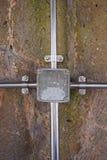 在金属的室外电子接线盒与输送管道 库存图片