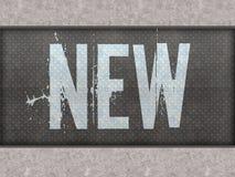 在金属盘区墙壁上绘的新 免版税库存图片