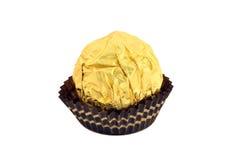 在金箔包裹的糖果被隔绝 免版税库存图片