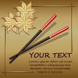 在金背景的筷子与抽象花 库存图片