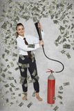 在金钱下雨的女实业家从灭火器的 库存图片