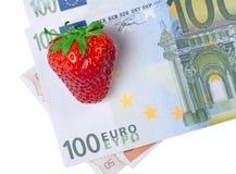 在金钱的莓果草莓 库存图片