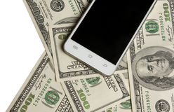 在金钱背景的电话  免版税库存图片
