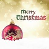 在金黄光的圣诞节装饰和问候 库存图片