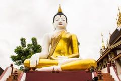 在金黄三角的大菩萨图象在Ubosot Wat王侯星期一Thian 库存图片
