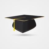 在金黄样式的毕业盖帽 向量 库存照片