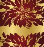 在金黄背景的红色花卉鞋带边界 免版税库存图片