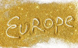 在金黄闪烁的题字欧洲在白色背景闪耀 免版税库存照片