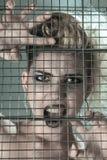 在钢笼子的时装模特儿 图库摄影
