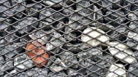 在钢笼子的石头,装饰墙壁 免版税库存图片