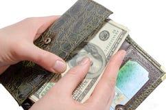 在钱包掩藏金钱 免版税库存照片