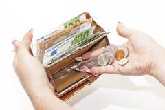 在钱包的金钱 免版税库存照片