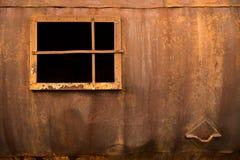 在铁墙壁的窗口 免版税库存照片