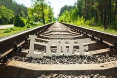 在铁路的白色爱 库存照片