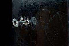 在铁门的匙孔 免版税库存图片