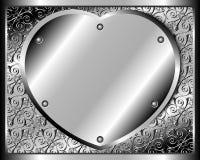 在铆钉的金属心脏 免版税库存照片