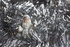 在银的圣诞老人形象闪耀backgraund 库存照片