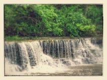 在银色小河的瀑布 库存图片