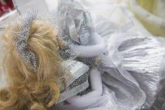 在银色礼服的美丽的玩偶 免版税图库摄影