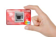 在银行现金ATM机器的修造在信用卡在妇女手上 3d 库存照片