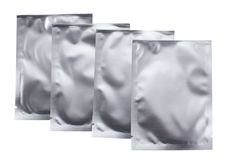 在银,被密封的包装的化妆物品 免版税图库摄影
