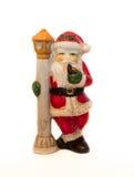 在锋利的北极的圣诞老人雕象,白色背景 免版税库存图片