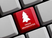 在键盘德语的圣诞快乐 免版税库存照片
