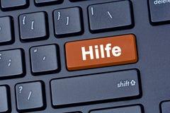 在键盘计算机上的Hilfe词 免版税库存照片