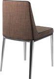 在镀铬物腿的设计师棕色用餐的椅子 在白色背景隔绝的现代软的椅子 免版税库存图片