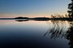 在镇静湖的黄昏 库存照片