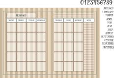 在镶边棕色几个月的背景和名字的月度计划者书 库存图片