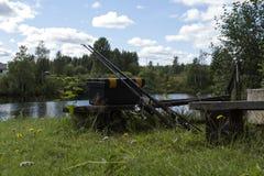 在长凳的捕鱼设备 免版税库存照片