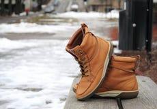 在长凳的鞋子 免版税图库摄影